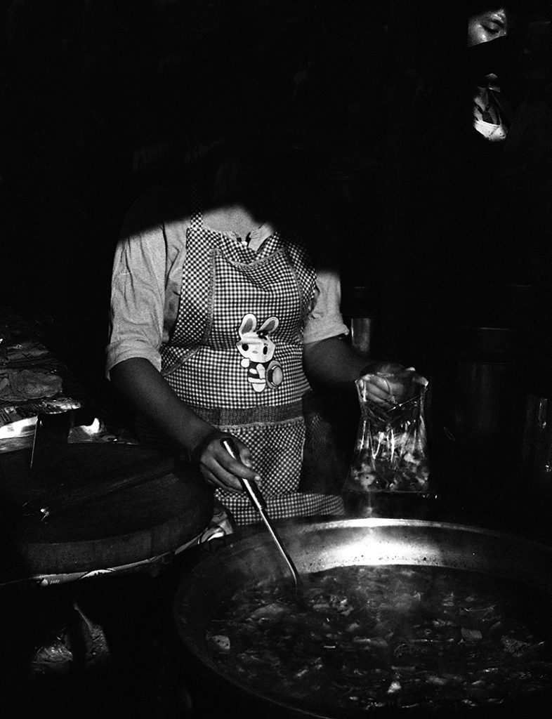 Thai cook at market Bangkok