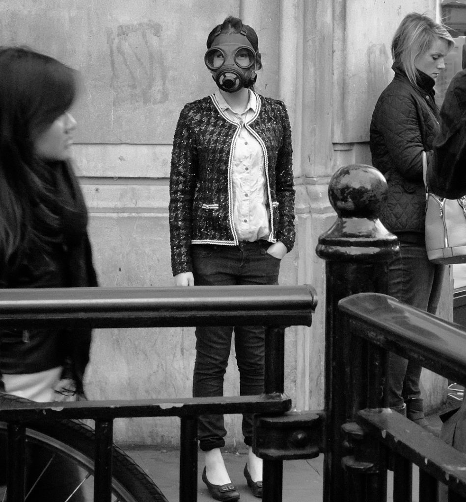 Girl with gas mask on at oxford circus